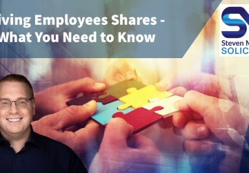 Giving employee shares - images shows employees holding a piece of jigsaw